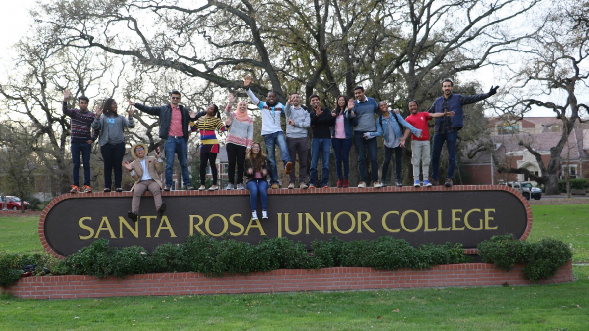 Students on SRJC Sign